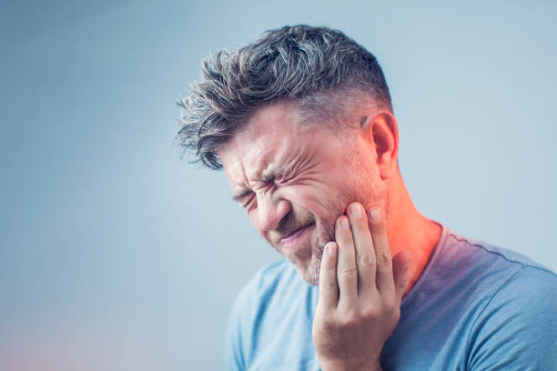 Toothache, medicine, health care concept, Teeth Problem, young man suffering from tooth pain, caries Toothache, medicine, health care concept, Teeth Problem, young man suffering from tooth pain, caries toothache stock pictures, royalty-free photos & images