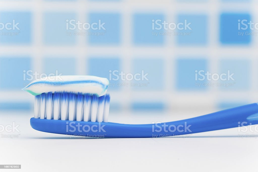 toothbrush against blue tile background royalty-free stock photo