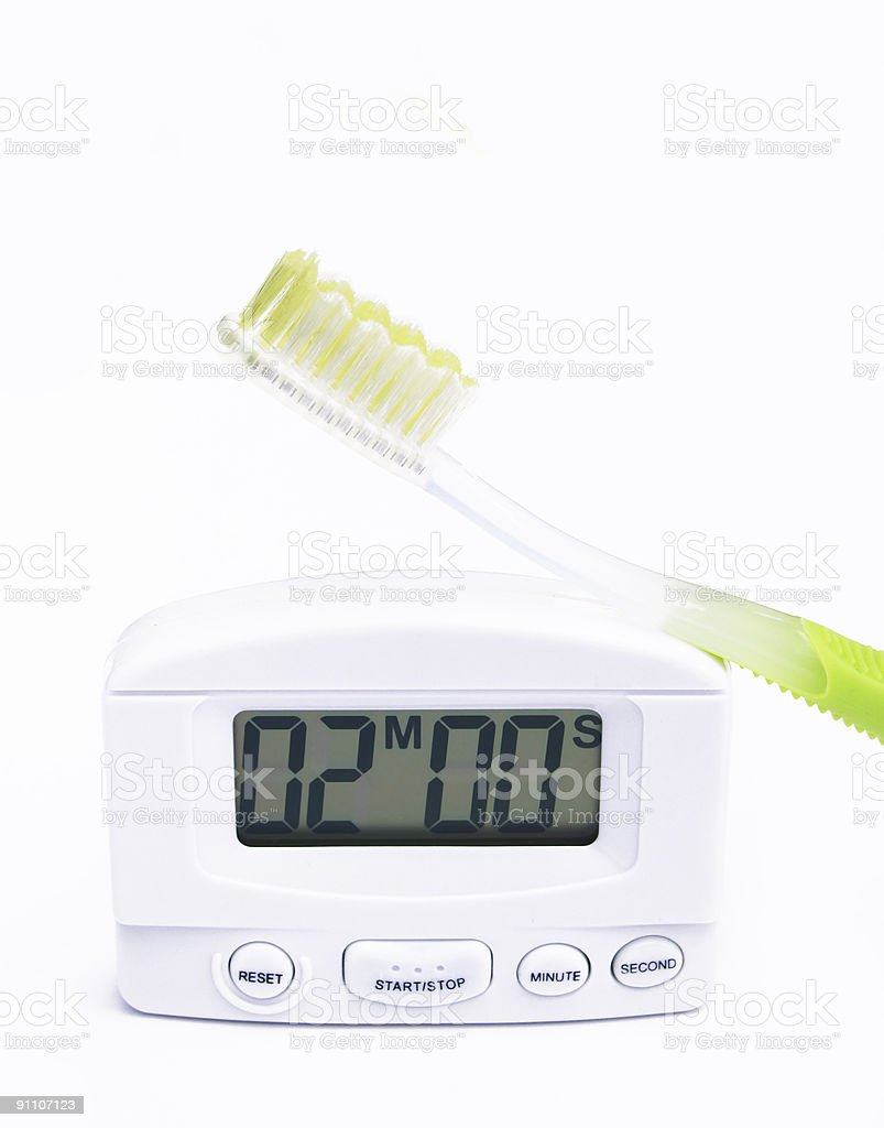toothbrush and timer stock photo