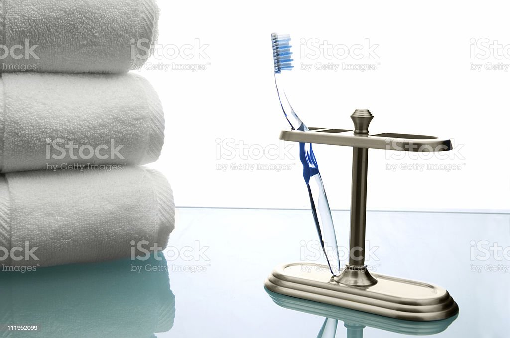 Toothbrush and Towels royalty-free stock photo