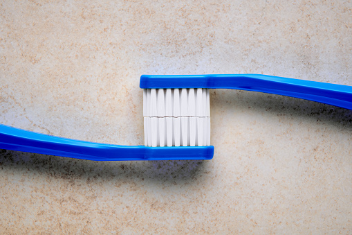 istock Toothbrush displaying pearl white teeth 1194110537