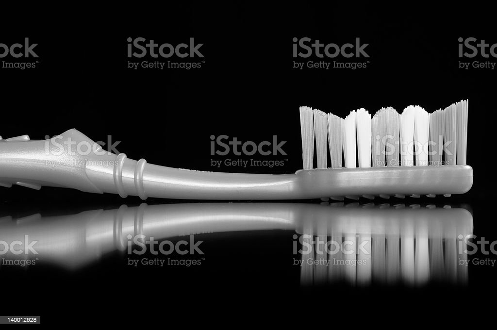Toothbrush on Black Background royalty-free stock photo