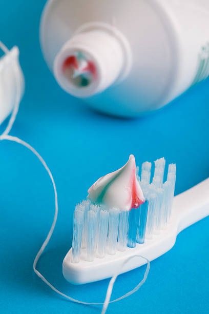Toothbrush, toothpaste and dental floss stock photo
