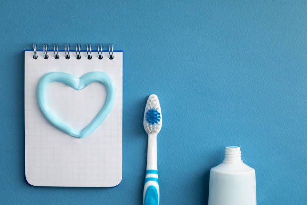 toothbrush with paste and a notebook stock photo