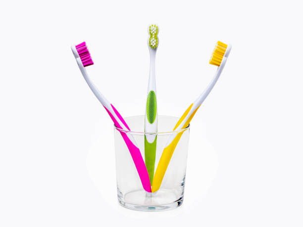 Toothbrushes in glass stock photo