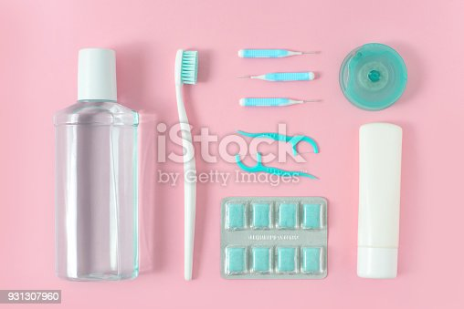 istock Toothbrushes, toothpaste, rinse and chewing gum set on pink background. Dental and healthcare concept. Free copy space. 931307960