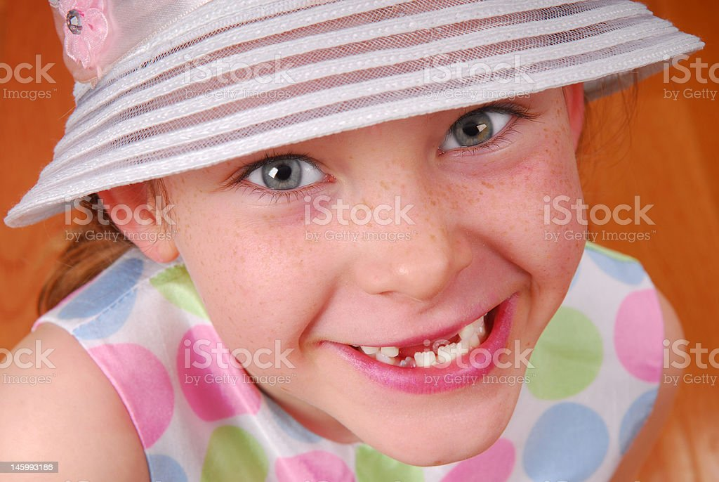 Toothless Girl in Hat stock photo