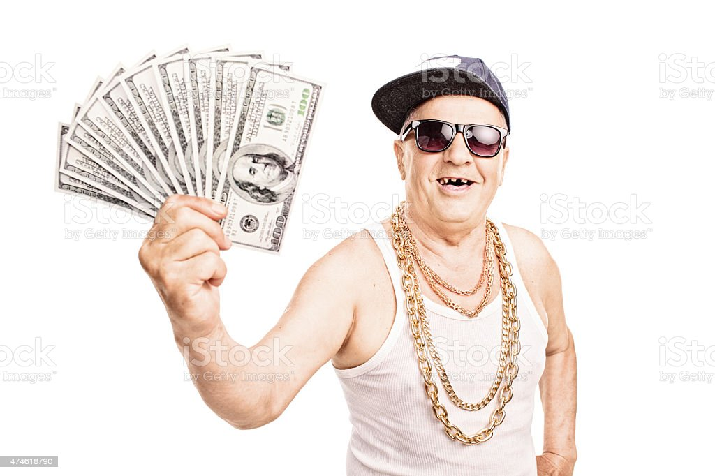 Toothless old man in hip-hop outfit holding cash stock photo