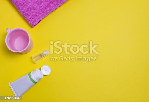 Toothpaste and brush for the youngest children, yellow background, toothpaste