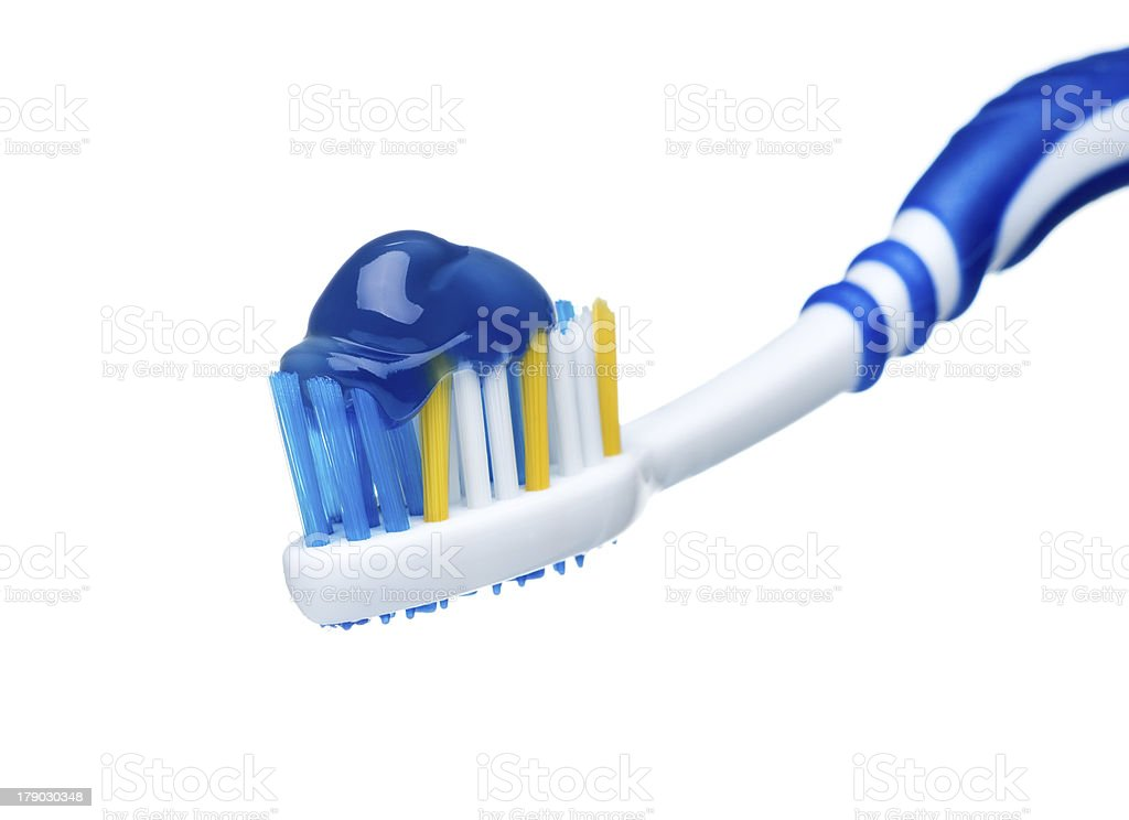 Toothpaste on blue toothbrush royalty-free stock photo