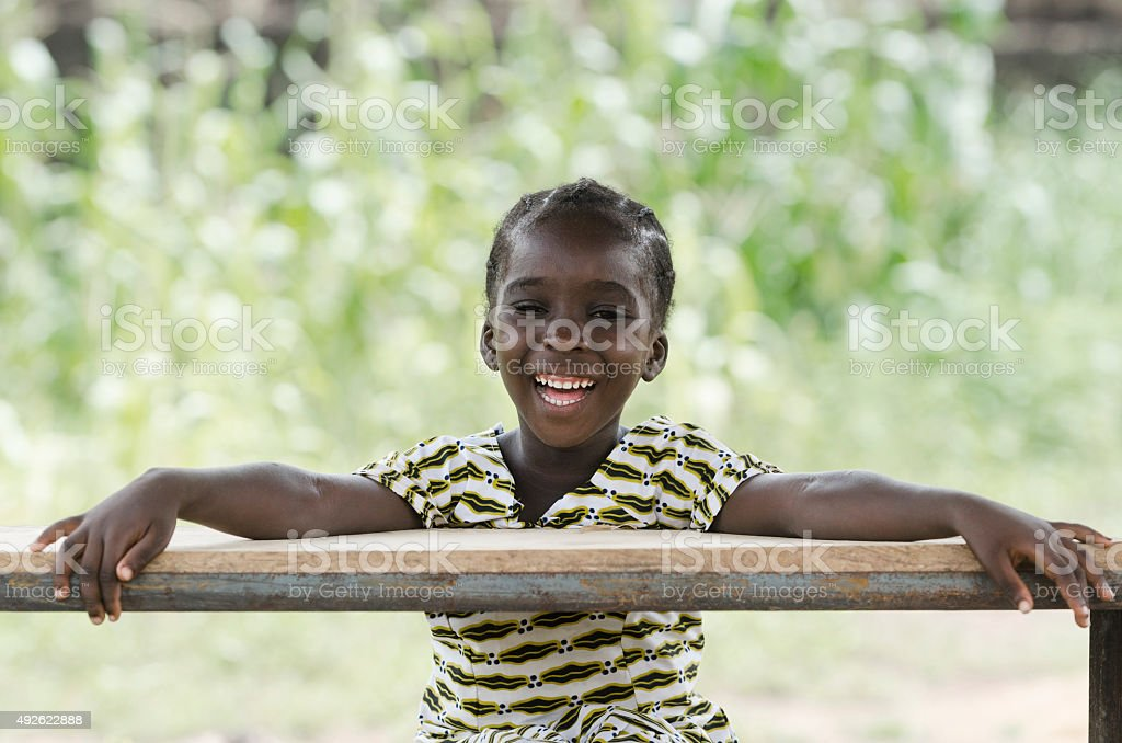 Toothy Smile on African Black Girl Laughing at School stock photo