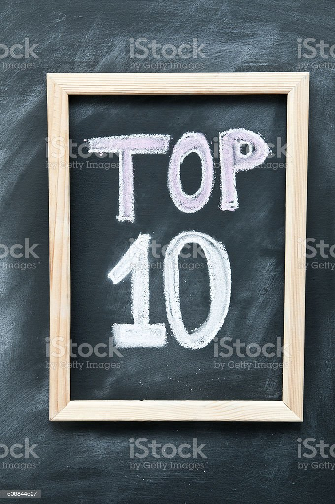 'Top 10'' written by chalk on a blackboard stock photo