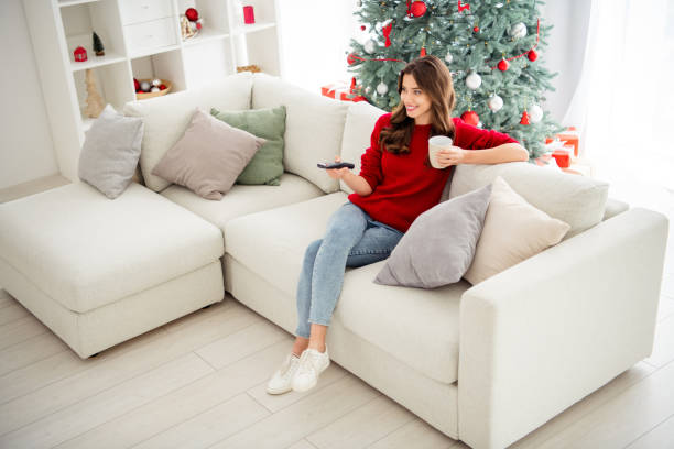 top above and high angle photo of cheerful cute girl wearing comfort jeans denim footwear having relax in front of television - christmas movie foto e immagini stock