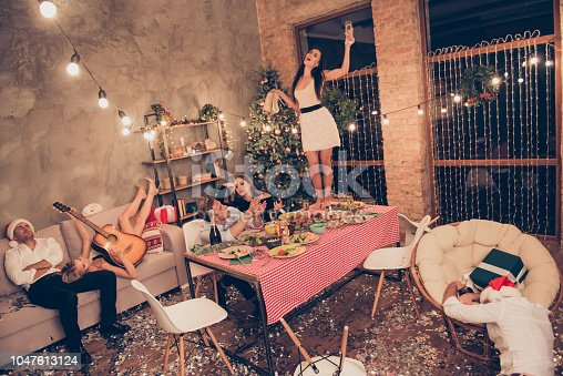 Top above high angle view of beautiful attractive stylish classy elegant cheerful funky people, girl dancing on dinner table with martini, guys sleeping, house chill-out