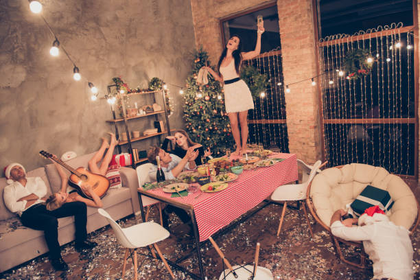 top above high angle view of beautiful attractive stylish classy elegant cheerful funky people, girl dancing on dinner table with martini, guys sleeping, house chill-out - drunk stock photos and pictures