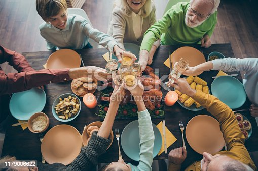 Top above high angle view of nice lovely cheerful cheery big full family brother sister eating domestic delicious feast clinking glass gratefulness tradition in loft industrial style interior house