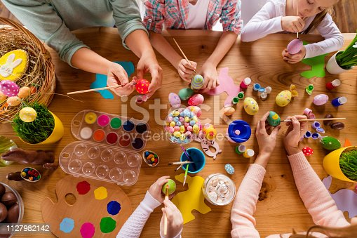 istock Top above high angle view of work place table nice group of people hands doing making decor accessory things classes courses studying in house indoors 1127982142