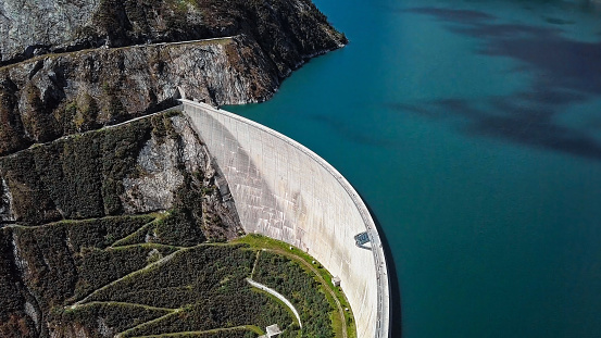 Top aerial view of Kolnbrein Dam and Malta road on Kolnbreinspeicher lake in Carinthia, Austria.
