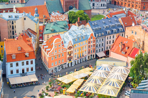 Top aerial view of the old town with beautiful colorful buildings in Riga, Latvia. Summer sunny day. European tourism concept.