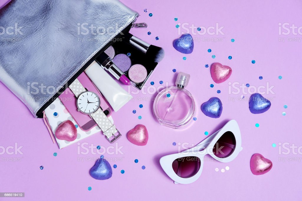 Top bag girl with accessories purple flat lay. Sweet sunglasses stock photo
