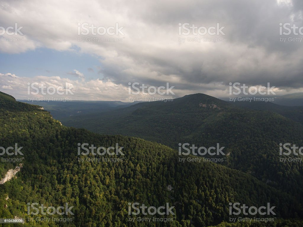 top Caucasus mountains under the cloudy sky. stock photo
