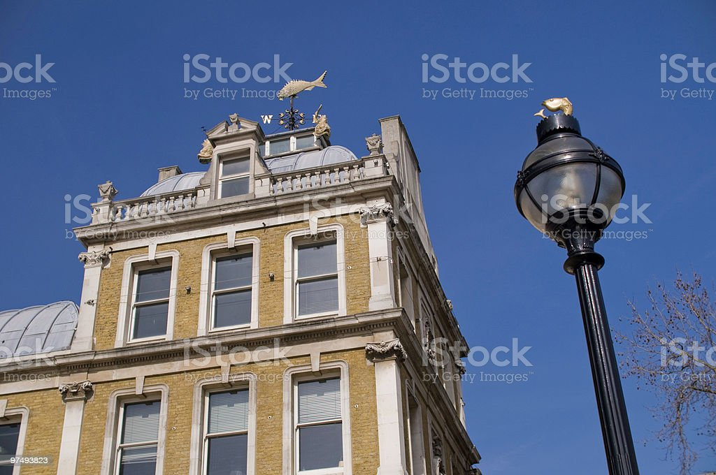 Top corner of a building against blue sky royalty-free stock photo