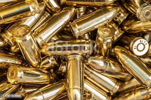 istock Top detail macro view of large group of gun bullets 1126180095