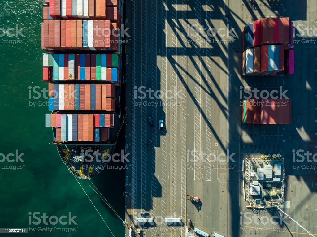 Top Down Aerial Of Container Ship In Port Stock Photo