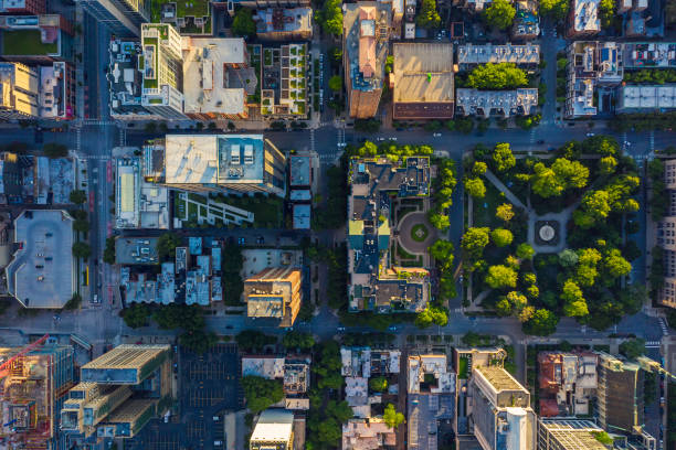 Top down aerial view of Chicago Downtown urban grid with park Top down aerial view of Chicago Downtown urban grid with park. Late afternoon light city life stock pictures, royalty-free photos & images
