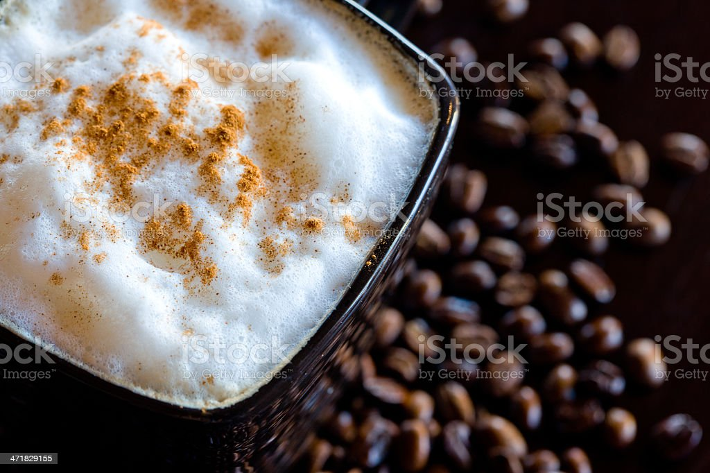 Top down Cappucino with nutmeg and coffee beans royalty-free stock photo