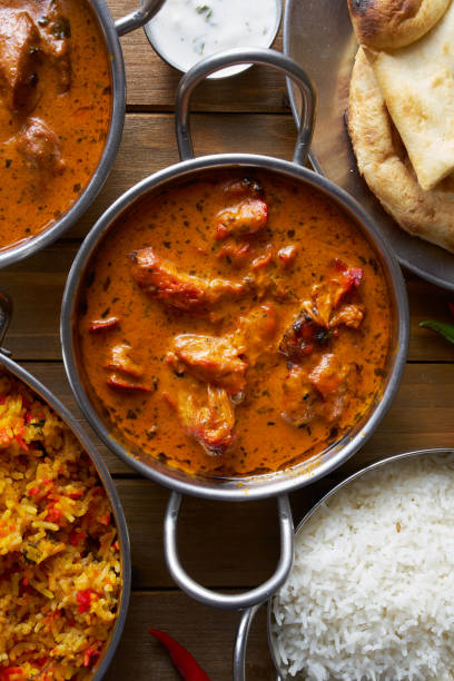 top down image of indian butter chicken in balta dish top down image of indian butter chicken in balta dish on wooden table balti dish stock pictures, royalty-free photos & images
