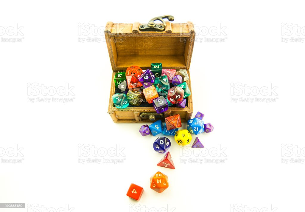 Top down of wooden chest overflowing with dice stock photo