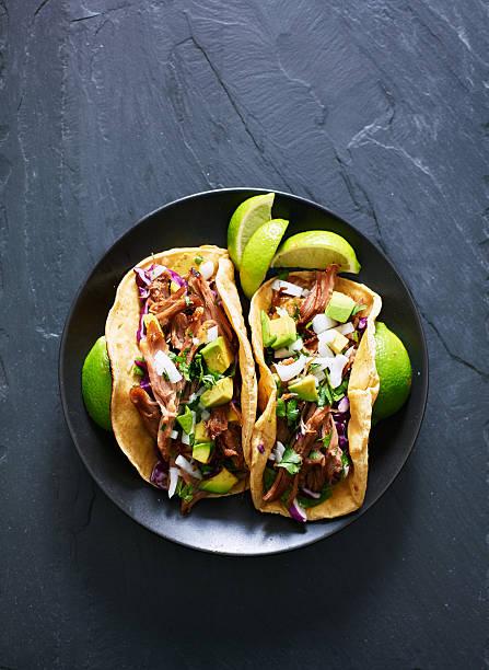 top down photo of two mexican carnitas tacos - taco foto e immagini stock
