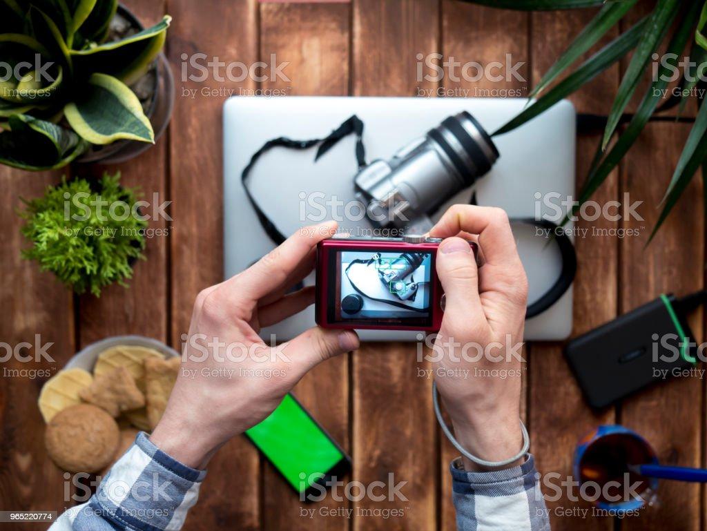 top down photographer making photoes using compact camera at home zbiór zdjęć royalty-free