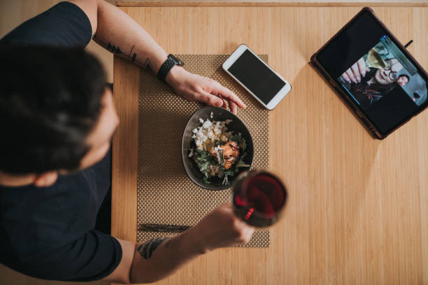 Top down shot of a virtual dinner with video call stock photo
