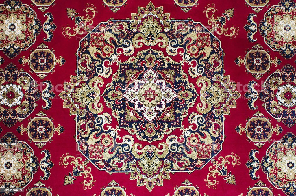 Top down shot of red Persian rug stock photo
