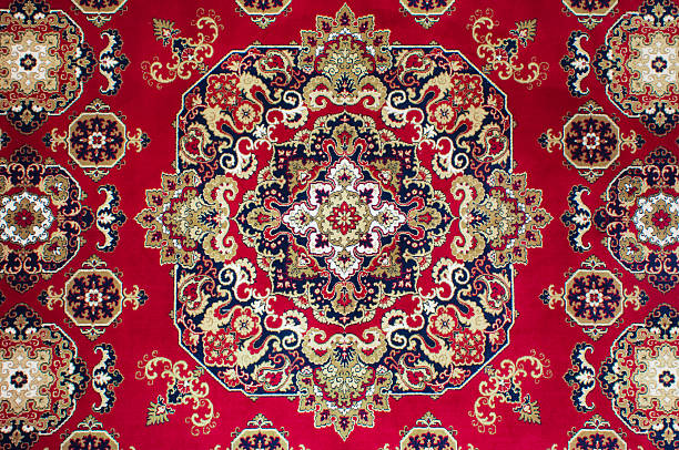 Top down shot of red Persian rug Oriental Persian Carpet Texture persian culture stock pictures, royalty-free photos & images