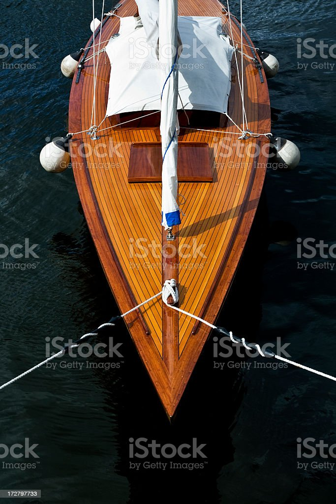 A top down view of a wooden decked sailboat's bow stock photo