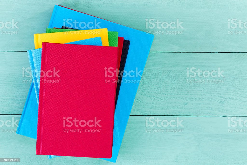 Top down view of blank books on blue table foto royalty-free