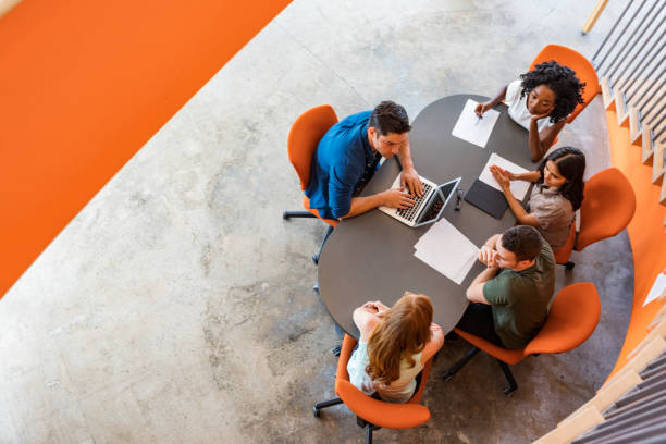Top Down View of Open Plan Business Meeting stock photo