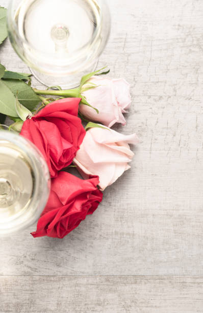 Top down view of two glasses of white wine with red and pink roses on picture id1126956010?b=1&k=6&m=1126956010&s=612x612&w=0&h=9tbncpjl3rpgei6bmav8u7nrj5uff2m9x6z9otihexk=