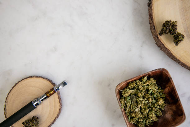 Top Down View of Vape Pen, Shake, Marijuana Buds on Wood - Cannabis Dispensary Products stock photo