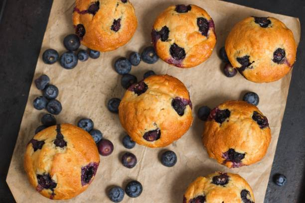 Top down view on fresh homemade gluten free blueberry muffins on baking tray stock photo