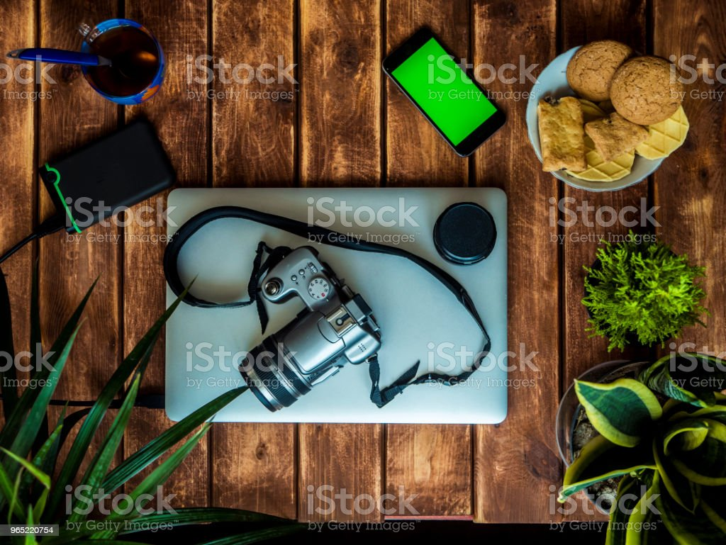 top down working place of a photograph on a wooden table royalty-free stock photo