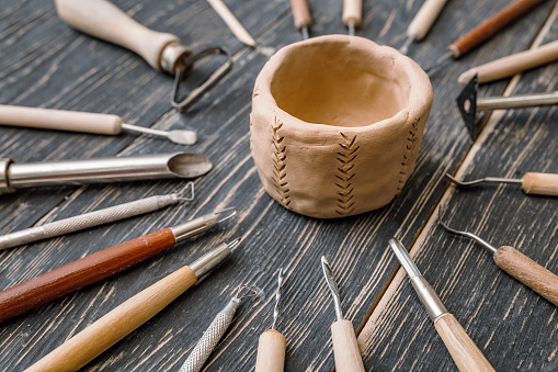 Top flat view of Pottery art tools, manual craft work concept