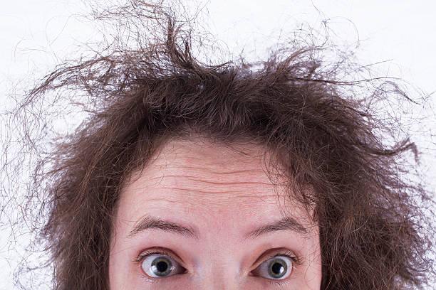 top half of surprised frizzy haired girls head - kabarık saç stok fotoğraflar ve resimler