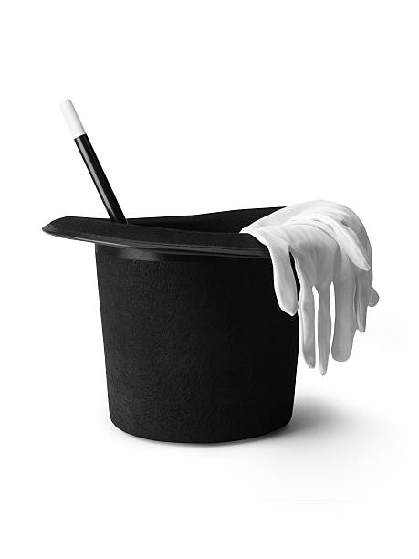 top hat magic wand gloves - Stock Image shot of a magicians top hat, gloves and magic wand isolated on a pure white background with a clipping path and copy space. magician stock pictures, royalty-free photos & images