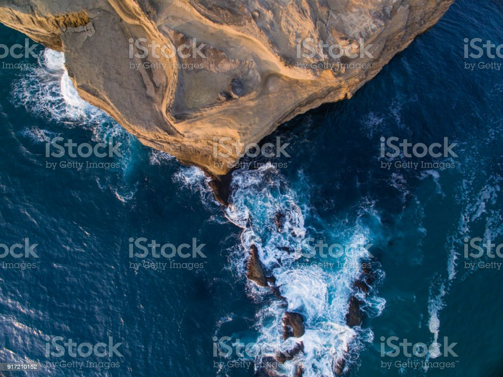 Top looking down at Castlepoint Lighthouse, during sunrise. stock photo