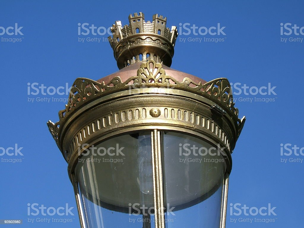 Top of a royal street lamp royalty-free stock photo