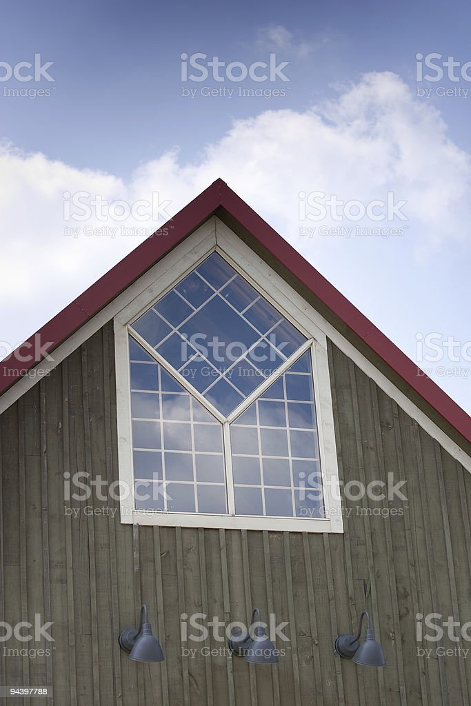 Top of A-frame building with custom window royalty-free stock photo